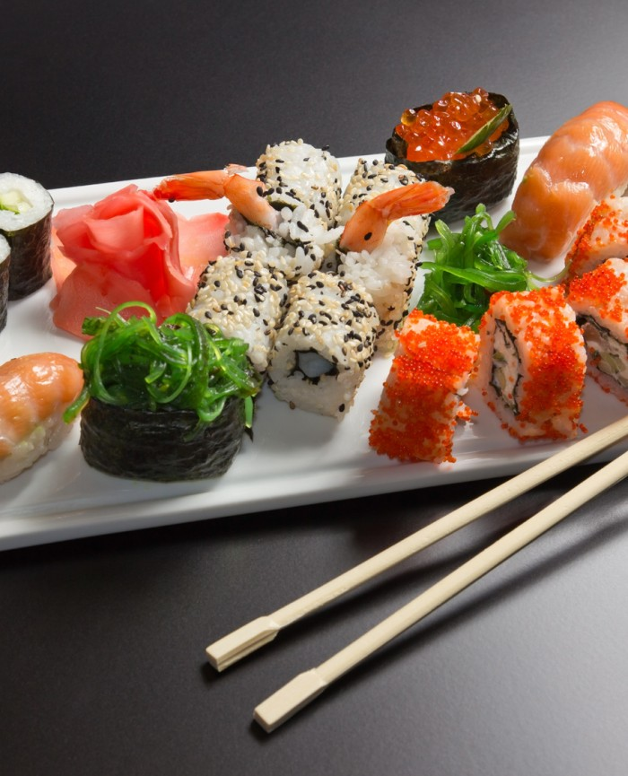 Japanese  seafood  sushi , roll and chopstick on a white plate